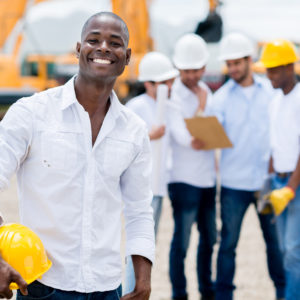 Male engineer at the construction site looking very happy